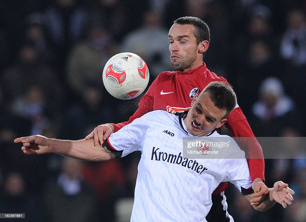 Pavel Krmas of Freiburg (above) challenges Alexander Meier during the Bundesliga match between SC Freiburg and Eintracht Frankfurt at MAGE SOLAR Stadium on February 22, 2013 in Freiburg, Germany.