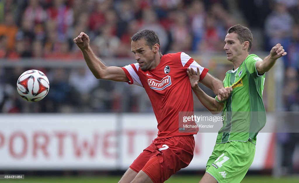 <a gi-track='captionPersonalityLinkClicked' href=/galleries/search?phrase=Pavel+Krmas&family=editorial&specificpeople=2220668 ng-click='$event.stopPropagation()'>Pavel Krmas</a> (L) of Freiburg challenges Branimir Hrgota (R) during the Bundesliga match between SC Freiburg and Borussia Moenchengladbach at Mage Solar Stadium on August 31, 2014 in Freiburg, Germany.