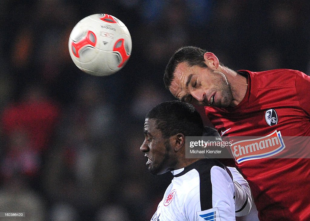 Pavel Krmas (R) of Freiburg challenges Olivier Occean during the Bundesliga match between SC Freiburg and Eintracht Frankfurt at MAGE SOLAR Stadium on February 22, 2013 in Freiburg, Germany.