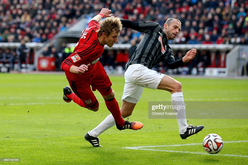 Pavel Krmas of Freiburg (R) challenges Stefan Kiessling of Leverkusen (L) during the Bundesliga match between Bayer 04 Leverkusen and SC Freiburg at BayArena on February 28, 2015 in Leverkusen, Germany.