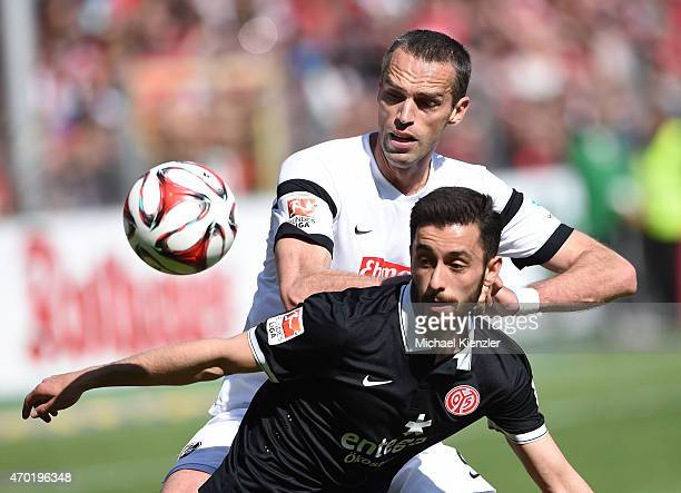 Pavel Krmas of SC Freiburg challenges Yunus Malli of 1 FSV Mainz 05 during the Bundesliga match between Sport Club Freiburg and 1 FSV Mainz 05 at...