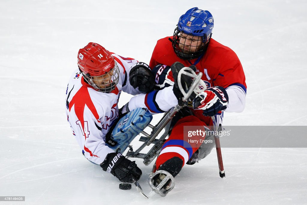 Pavel Kubes of Czech Republic (R) collides with Seung-Hwan Jung of Korea during the Ice Sledge Hockey Classification match between the Czech Republic and Korea at the Shayba Arena during day five of the 2014 Paralympic Winter Games on March 12, 2014 in Sochi, Russia.