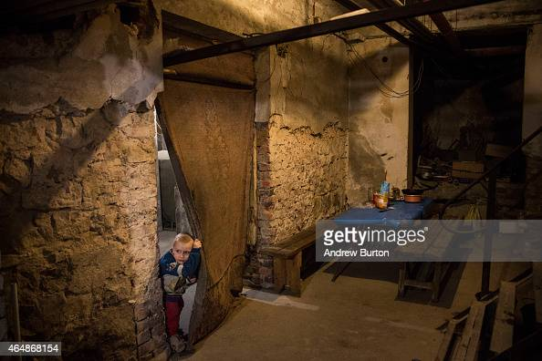 Pavel Makeev age 5 peeks his head through a door way while waiting for lunch to be cooked in the basement of the Petrovskiy neighborhood cultural...