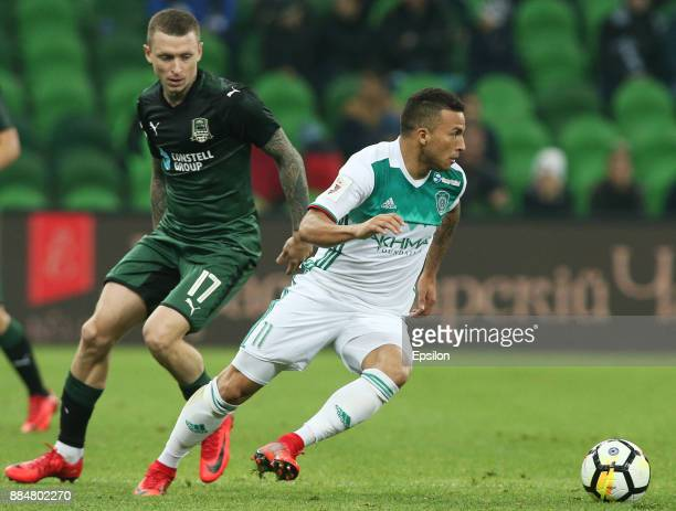 Pavel Mamayev of FC Krasnodar vies for the ball with Ismael of FC Akhmat Grozny during the Russian Premier League match between FC Krasnodar and FC...