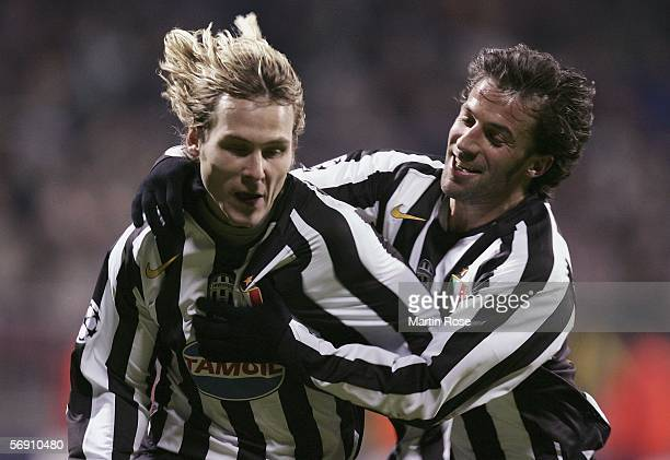 Pavel Nedved and Alessandro del Pierro of Juventus celebrate the 2nd goal during the UEFA Champions League round sixteen first leg match between...