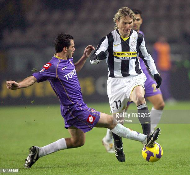 Pavel Nedved of Juventus and Luciano Zauri of Fiorentina in action during the Serie A match between Juventus and Fiorentina at the Olimpico Stadio on...