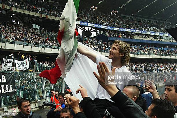 Pavel Nedved of Juventus celebrates the title win with the fans after the Italian Serie A match between Juventus and Perugia held on May 10 2003 at...