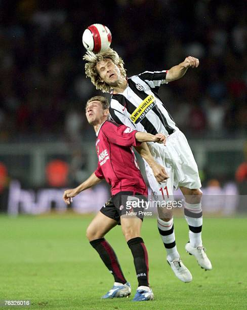 Pavel Nedved of Juventus competes for a headerduring the Serie A match between Juventus FC and AS Livorno Calcio at the Stadio Olimpico di Torino on...