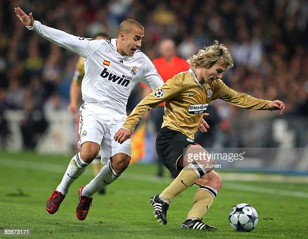 Pavel Nedved of Juventus duels for the ball with Fabio Cannavaro of Real Madrid during the UEFA Champions League Group H match between Real Madrid...