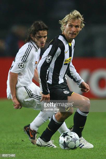 Pavel Nedved of Juventus gets away from Fernando Gago of Real Madrid during the UEFA Champions League Group H match between Juventus and Real Madrid...