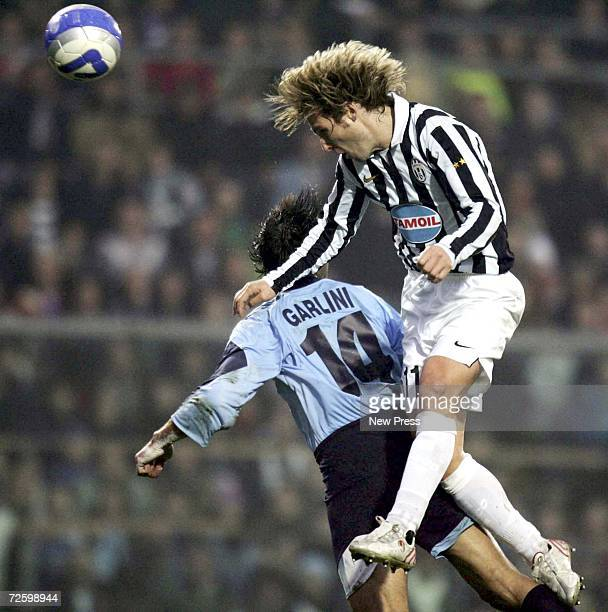 Pavel Nedved of Juventus rises above Ruben Garlini of Albinoleffe during the Serie B match between Albinoleffe and Juventus at the Atleti Azzurri...