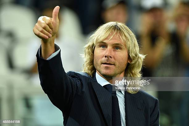 Pavel Nedved of Juventus salutes the fans prior to the group A match between Juventus and Malmo FF on September 16 2014 in Turin Italy
