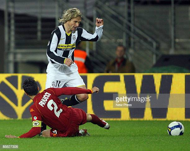 Pavel Nedved of Juventus skips past Christian Panucci of Roma during the Serie A match between Juventus and Roma at the Olimpic Stadio on November 01...