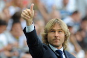 Pavel Nedved salutes the fans of Juventus prior to the Serie A match between Juventus and Cagliari Calcio at Juventus Arena on May 11 2013 in Turin...