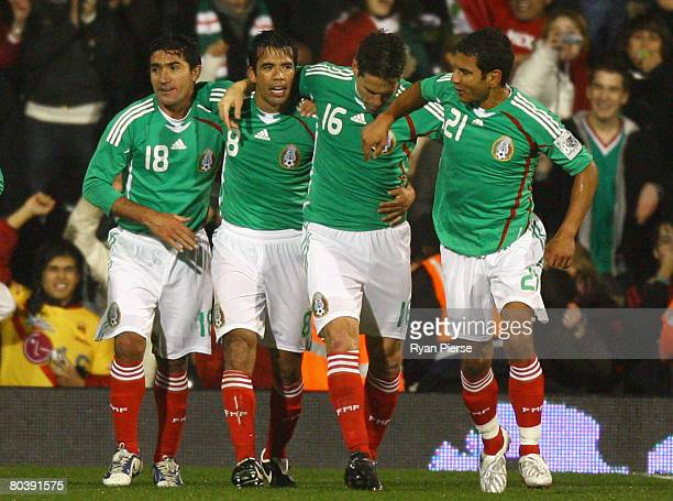 Pavel Pardo of Mexico celebrates with teammates after scoring his team's second goal during the international friendly match between Ghana and Mexico...