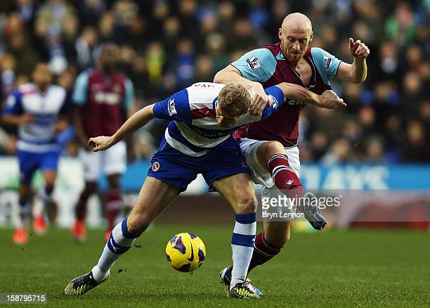 Pavel Pogrebnyak of Reading battles with James Collins of West Ham United during the Barclays Premier League match between Reading and West Ham...