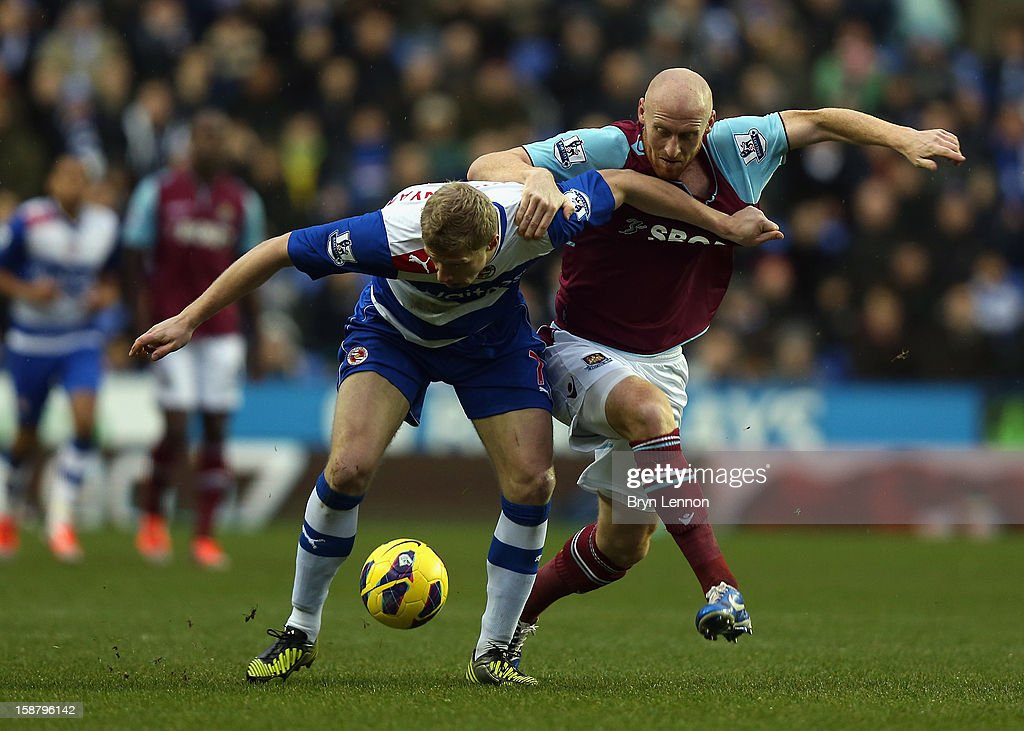 Pavel Pogrebnyak of Reading battles with James Collins of West Ham United during the Barclays Premier League match between Reading and West Ham United at the Madejski Stadium on December 29, 2012 in Reading, England.