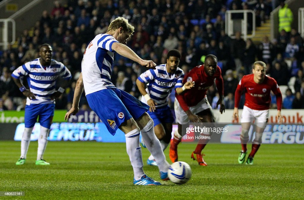 Pavel Pogrebnyak of Reading scores his team's first goal during the Sky Bet Championship match between Reading and Barnsley at Madejski Stadium on March 25, 2014 in Reading, England,