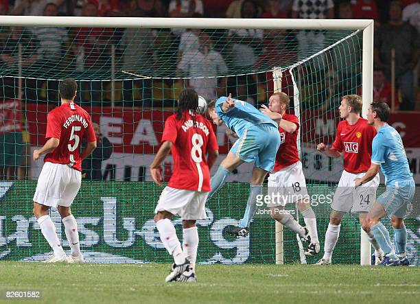 Pavel Pogrebnyak of Zenit St Petersburg scores their first goal during the UEFA Supercup match between Manchester United and Zenit St Petersburg at...