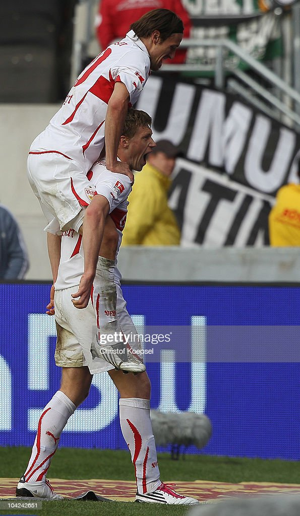 Pavel Progrebnyak (low) celebrates his thrid goal with Christian Gentner of Stuttgart during the Bundesliga match between VfB Stuttgart and Borussia Moenchengladbach at Mercedes-Benz Arena on September 18, 2010 in Stuttgart, Germany.