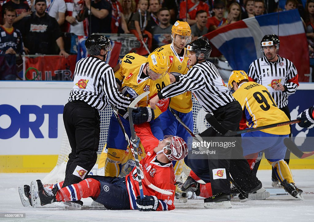 Pavel Sedlacek #94 of PSG Zlin and T.J. Mulock #15 of Eisbären Berlin fight during the Champions Hockey League group stage game between Eisbaeren Berlin and HC Zlin on August 22, 2014 in Berlin, Germany.
