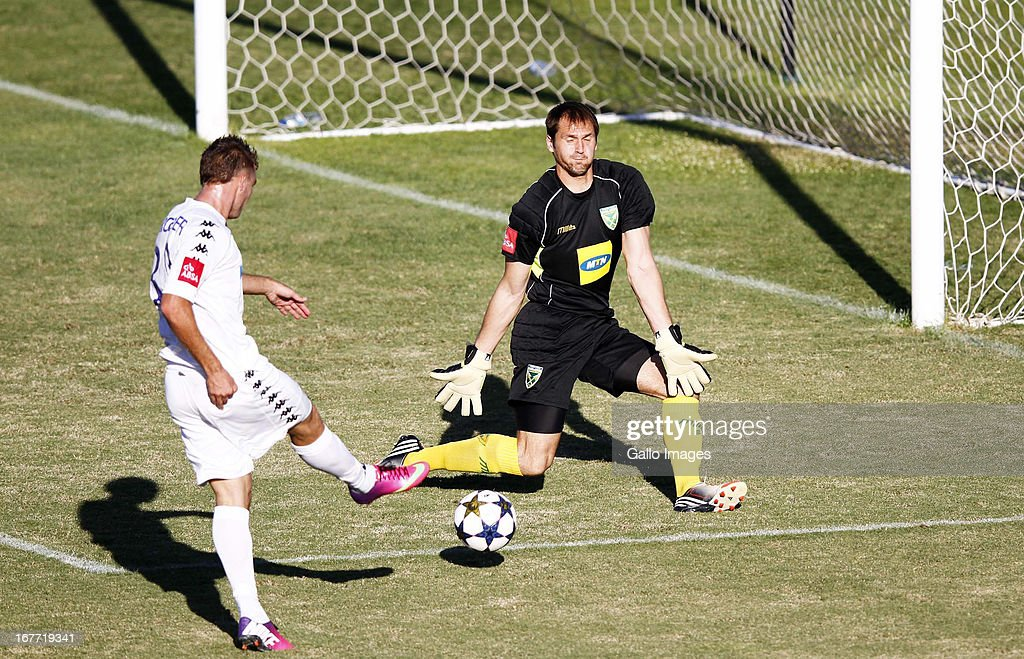 Pavel Steinbors saves the shot from Bradley Grobler during the Absa Premiership match between Golden Arrows and SuperSport United at Princess Magogo Stadium on April 28, 2013 in Durban, South Africa.