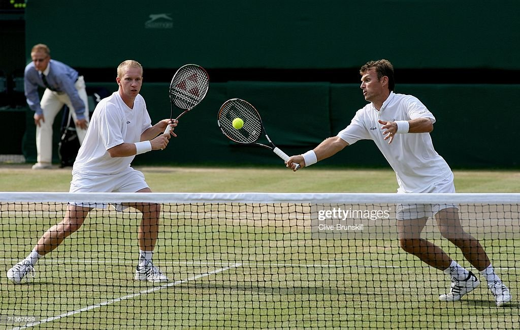 Pavel Vizner and Lukas Dlouhy of Czech Republic in action during their doubles match against Mike Bryan and Bob Bryan of the United States during day...