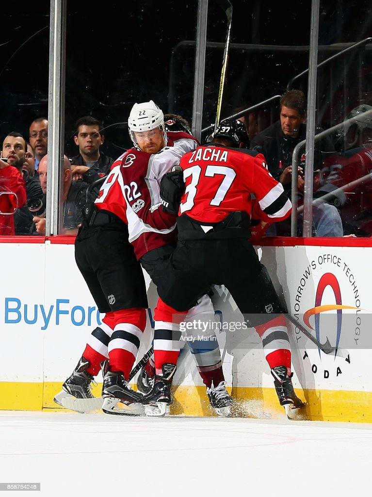 Pavel Zacha #37 of the New Jersey Devils and Colin Wilson #22 of the Colorado Avalanche battle for position during the Devils season opener at Prudential Center on October 7, 2017 in Newark, New Jersey.
