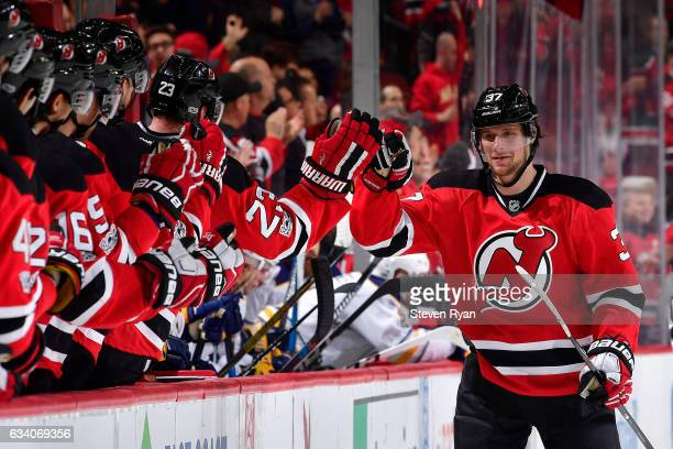 Pavel Zacha of the New Jersey Devils is congratulated by his teammates after scoring a third period goal against the Buffalo Sabres at Prudential...