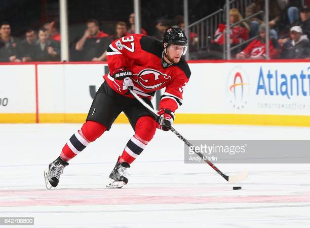 Pavel Zacha of the New Jersey Devils plays the puck against the Ottawa Senators during the game at Prudential Center on February 16 2017 in Newark...