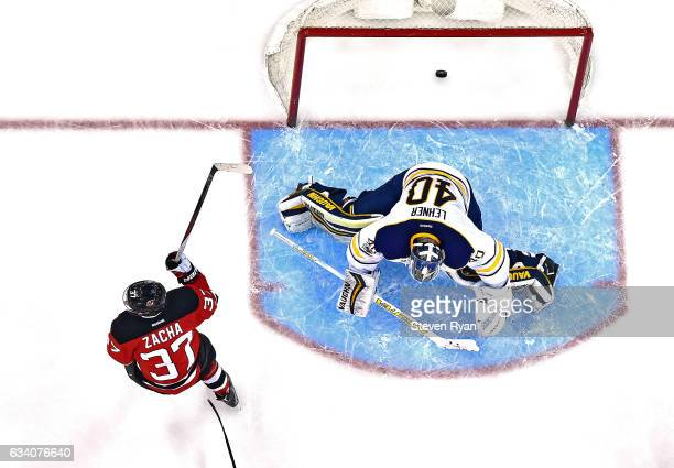 Pavel Zacha of the New Jersey Devils scores the eventual game winning goal past Robin Lehner of the Buffalo Sabres during the third period at...