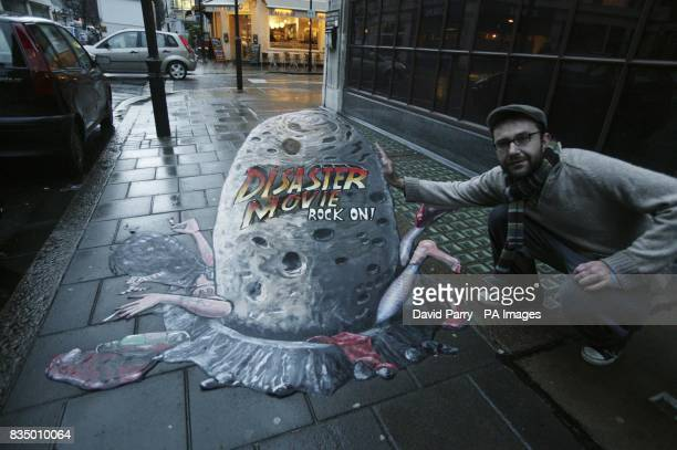 Pavement artist Joe Hill with his 3D pavement art in Covent Garden London to mark the launch of Disaster Movie the latest slapstick spoof hit from...