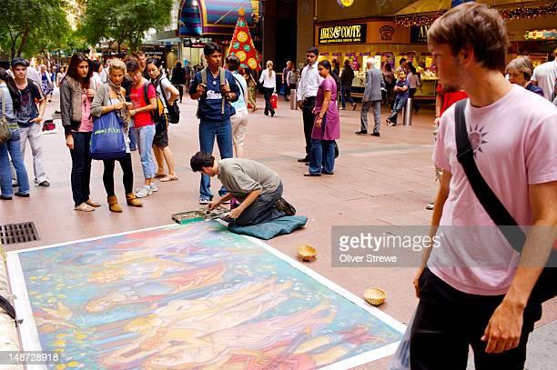 Pavement artist on Pitt Street Mall.