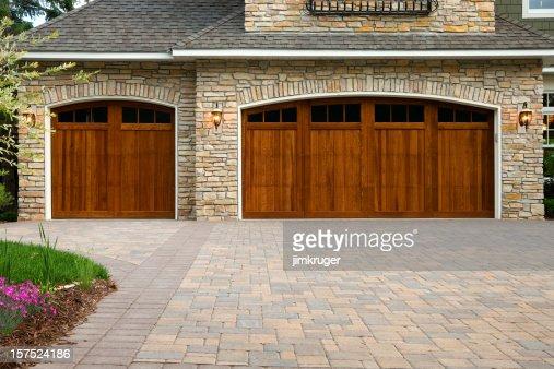 Pavers, custom doors, and stone on upscale home.