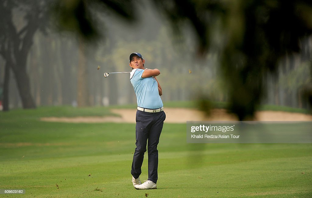 Pavit Tangkamolprasert of Thailand plays a shot during round two of the Bashundhara Bangladesh Open at Kurmitola Golf Club on February 11, 2016 in Dhaka, Bangladesh.