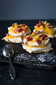 Pavlova dessert with lemon curd, fresh figs and poppy seed. Vertical, selective focus