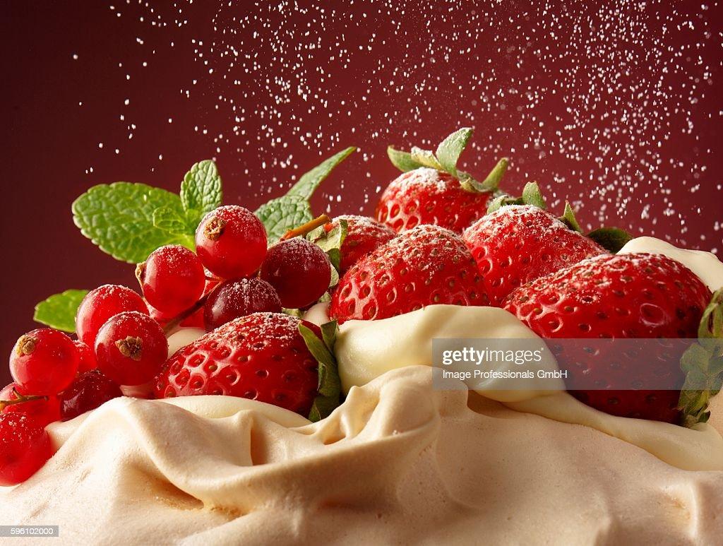 Pavlova with summer fruits and sugar