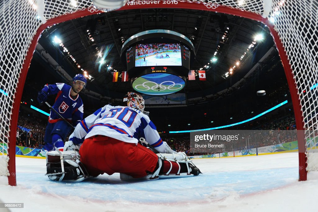<a gi-track='captionPersonalityLinkClicked' href=/galleries/search?phrase=Pavol+Demitra&family=editorial&specificpeople=204485 ng-click='$event.stopPropagation()'>Pavol Demitra</a> (L) of Slovakia scores the game-winning goal against <a gi-track='captionPersonalityLinkClicked' href=/galleries/search?phrase=Ilya+Bryzgalov&family=editorial&specificpeople=2285430 ng-click='$event.stopPropagation()'>Ilya Bryzgalov</a> of Russia during the ice hockey men's preliminary game between Slovakia and Russia on day 7 of the 2010 Winter Olympics at Canada Hockey Place on February 18, 2010 in Vancouver, Canada.