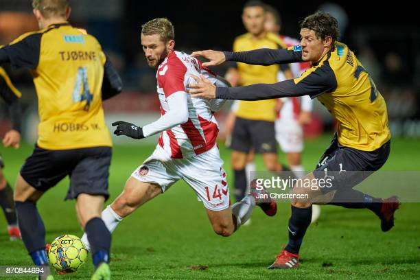 Pavol Safranko of AaB Aalborg and Rasmus Minor Petersen of Hobro IK compete for the ball during the Danish Alka Superliga match between Hobro IK and...