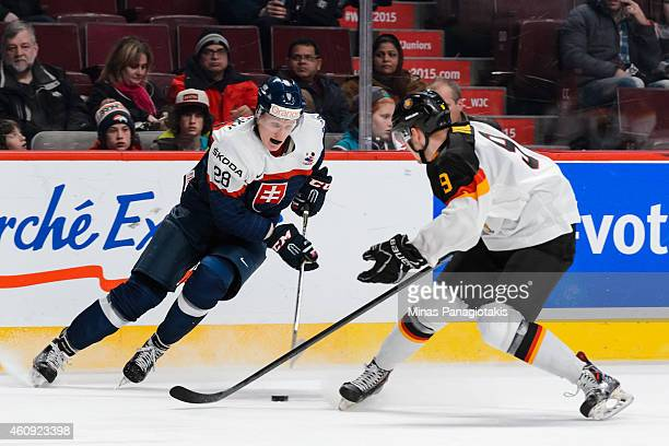 Pavol Skalicky of Team Slovakia tries to get the puck past Patrick Kurz of Team Germany during the 2015 IIHF World Junior Hockey Championship game at...