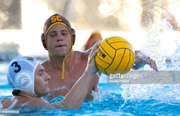 Pavol Valovic of USC pressures Brian Bacharach of CalBerkeley during the Division I Men's Water Polo Championship held at the Burns Recreation and...