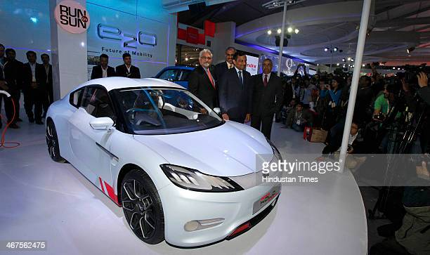 Pawan Goenka President of Mahindra's automotive and farm equipment sectors stands next to Mahindra's concept electric sports car 'Halo' after its...