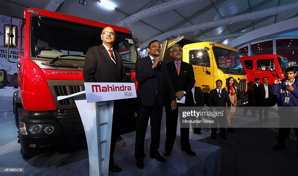 Pawan Goenka (C), President of Mahindra's automotive and farm equipment sectors, stands next to Mahindra's new range of trucks during 12th Auto Expo, at India Expo Mart on February 6, 2014 in Greater Noida, India. Mahindra and Mahindra Ltd, India's largest utility vehicle maker, and South Korean company Ssangyong Motor Co Ltd will launch their first jointly developed engine in the first quarter of 2015, a senior executive of the Indian company said.
