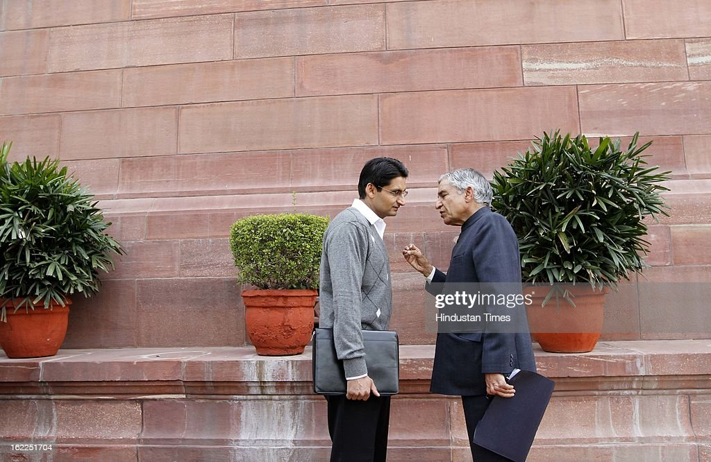 Pawan Kumar Bansal (R) Union Minister for Railways with Deepender Singh Hooda at the Parliament house , beginning of the budget session on February 21, 2013 in New Delhi, India.
