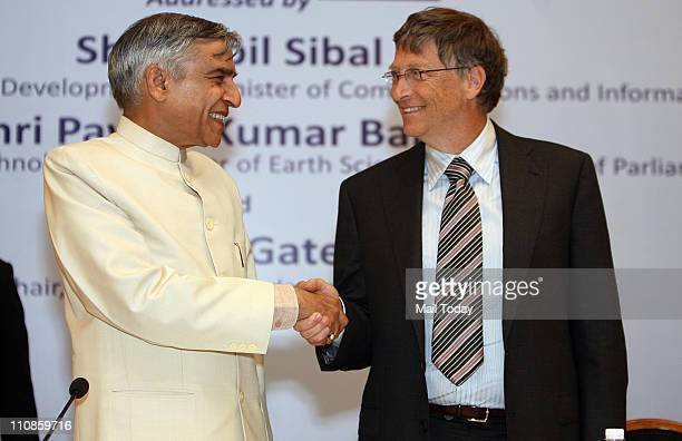 Pawan Kumar Bansal Union Minister of Science and Technology Earth Sciences and Parliamentary Affairs and Microsoft founder Bill Gates shake hands...