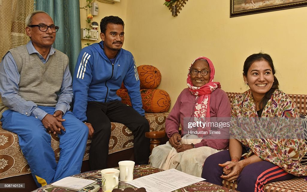 Pawan Negi with his family at his home after he was bought by Delhi Daredevils Team for IPL season 2016 for 8.5 crores, on February 6, 2016 in New Delhi , India. He is a slow left-arm orthodox bowler. He plays for Delhi in the first-class Ranji Trophy competition, and has also played List A and Twenty20 cricket for the team. His family hails from Almora in Uttarakhand. He studied from Delhi Public School, New Delhi.