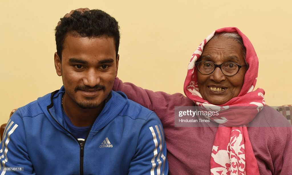 Pawan Negi with his grand mother at his home after he was bought by Delhi Daredevils Team for IPL season 2016 for 8.5 crores, on February 6, 2016 in New Delhi , India. He is a slow left-arm orthodox bowler. He plays for Delhi in the first-class Ranji Trophy competition, and has also played List A and Twenty20 cricket for the team. His family hails from Almora in Uttarakhand. He studied from Delhi Public School, New Delhi.
