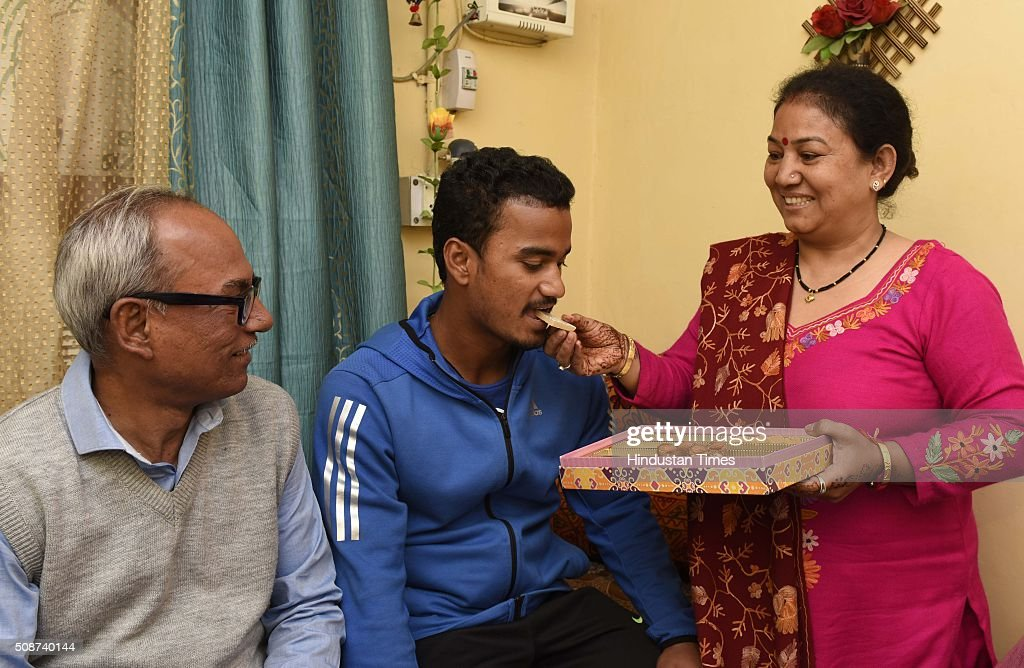 Pawan Negi with his parents at his home after he was bought by Delhi Daredevils Team for IPL season 2016 for 8.5 crores, on February 6, 2016 in New Delhi , India. He is a slow left-arm orthodox bowler. He plays for Delhi in the first-class Ranji Trophy competition, and has also played List A and Twenty20 cricket for the team. His family hails from Almora in Uttarakhand. He studied from Delhi Public School, New Delhi.