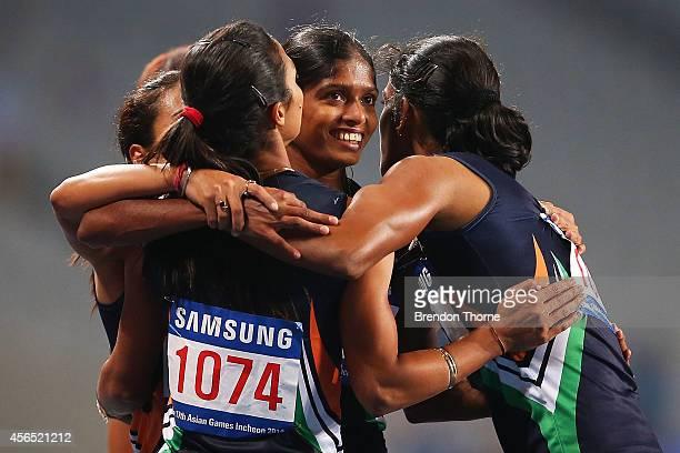 Pawar Priyanka Lukka Tintu Kaur Mandeep and Poovamma Raju Machettira of India celebrate claiming the Gold medal in the Women's 4x400m Relay Final...
