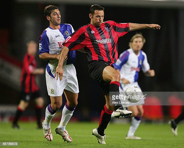 Pawel Abbott of Huddersfield Town holds off a challenge from Zurab Khizanishvili of Blackburn Rovers during the Carling Cup second round match...
